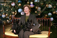 Mrs. Laura Bush sits with Barney and Miss Beazley before the White House Christmas tree, Wednesday, Nov. 30, 2007, in the Blue Room of the White House.