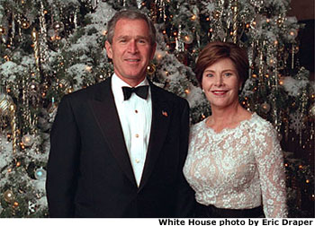 Photo of President and First Lady in front of 2001 White House Christmas Tree. White House photo by Eric Draper.