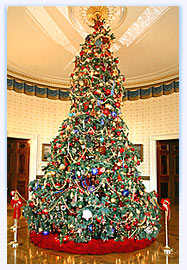 The Official 2004 Christmas tree stands in the center of the Blue Room