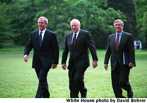 Photograph of the President, Vice President and former Chief of Staff walking across the White House Lawn. White House photo by David Bohrer.