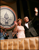 President George W. Bush and Laura Bush greet the audience during the Texas State Society's Black Tie and Boots Inaugural Ball in Washington, D.C., Jan. 19, 2005. White House photo by Eric Draper.
