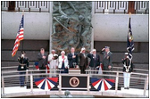 President George W. Bush joins fellow veterans in standing at attention during the playing of the National Anthem at the dedication of the National D-Day Memorial in Bedford, Va., June 6, 2001. The memorial was built to honor those who served and died during Operation Overlord in the D-Day invasion at Normandy, France, June 6, 1944.