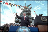 "Addressing veterans, servicemen and women and families, President George W. Bush gives a thumbs-up during his speech marking the anniversary of Pearl Harbor on the U.S.S. Enterprise Dec. 7, 2001. ""What happened at Pearl Harbor was the start of a long and terrible war for America. Yet, out of that surprise attack grew a steadfast resolve that made America freedom's defender. And that mission -- our great calling -- continues to this hour, as the brave men and women of our military fight the force of terror in Afghanistan and around the world,"" said the President."