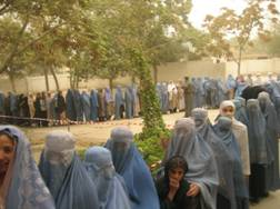 Women line up to vote in Afghanistan's first presidential election. USAID Photo