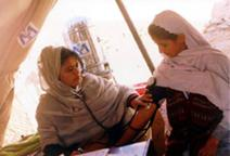 This Afghan doctor provides medical care to Afghan women. USAID's maternal and child health program has been working very closely with the Ministry of Public Health to provide essential services to the Afghan people. USAID Photo