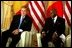 President George W. Bush meets with President Abdoulaye Wade of Senegal at the Presidential Palace in Dakar, Senegal, Tuesday morning, July 8, 2003. White House photo by Paul Morse