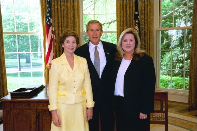 President George W. Bush and Laura Bush congratulate 2003 Maine Teacher of the Year Lorraine Johnson in the Oval Office Wednesday, April 30, 2003. White House Photo by Eric Draper