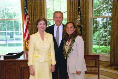 President George W. Bush and Laura Bush congratulate 2003 Maine Teacher of the Year Roberta R. Zarbaugh in the Oval Office Wednesday, April 30, 2003. White House Photo by Eric Draper