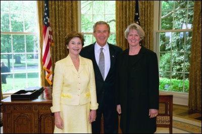 President George W. Bush and Laura Bush congratulate 2003 Maine Teacher of the Year Patricia R. Perry in the Oval Office Wednesday, April 30, 2003. White House Photo by Eric Draper