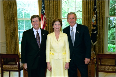 President George W. Bush and Laura Bush congratulate 2003 Maine Teacher of the Year Robert D. Grimm in the Oval Office Wednesday, April 30, 2003. White House Photo by Eric Draper