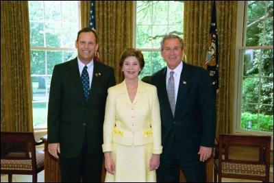 President George W. Bush and Laura Bush congratulate 2003 Maine Teacher of the Year Robert W. Pickett in the Oval Office Wednesday, April 30, 2003. White House Photo by Eric Draper