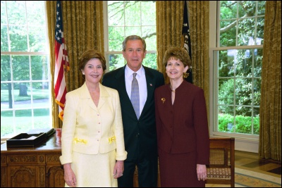 President George W. Bush and Laura Bush congratulate 2003 Maine Teacher of the Year Diana Buter in the Oval Office Wednesday, April 30, 2003. White House Photo by Eric Draper