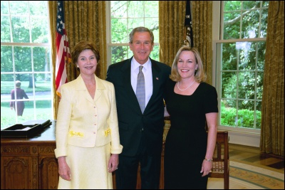 President George W. Bush and Laura Bush congratulate 2003 Maine Teacher of the Year Ruth Ann Gharst in the Oval Office Wednesday, April 30, 2003. White House Photo by Eric Draper
