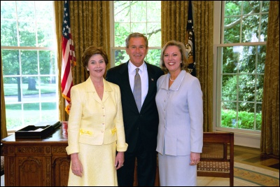 President George W. Bush and Laura Bush congratulate 2003 Maine Teacher of the Year Patrice P. McCrary in the Oval Office Wednesday, April 30, 2003. White House Photo by Eric Draper