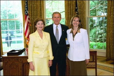President George W. Bush and Laura Bush congratulate 2003 Maine Teacher of the Year Betsy Ann Wandishin in the Oval Office Wednesday, April 30, 2003. White House Photo by Eric Draper