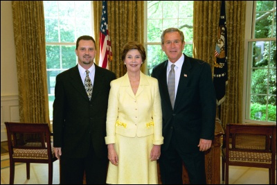 President George W. Bush and Laura Bush congratulate 2003 Maine Teacher of the Year Darren Ray Hornbeck in the Oval Office Wednesday, April 30, 2003. White House Photo by Eric Draper