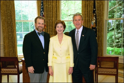 President George W. Bush and Laura Bush congratulate 2003 Maine Teacher of the Year Jeffrey R. Ryan in the Oval Office Wednesday, April 30, 2003. White House Photo by Eric Draper