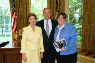 President George W. Bush and Laura Bush congratulate 2003 Maine Teacher of the Year Susan L. Gutierrez in the Oval Office Wednesday, April 30, 2003. White House Photo by Eric Draper