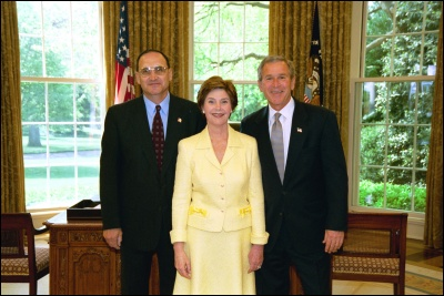 President George W. Bush and Laura Bush congratulate 2003 Maine Teacher of the Year Paul M. Cuicchi in the Oval Office Wednesday, April 30, 2003. White House Photo by Eric Draper
