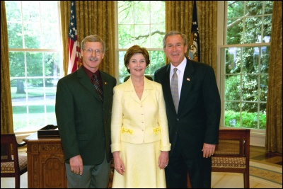 President George W. Bush and Laura Bush congratulate 2003 Maine Teacher of the Year Jon Dean in the Oval Office Wednesday, April 30, 2003. White House Photo by Eric Draper
