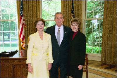 President George W. Bush and Laura Bush congratulate 2003 Maine Teacher of the Year Suzanne Ratzlaff in the Oval Office Wednesday, April 30, 2003. White House Photo by Eric Draper