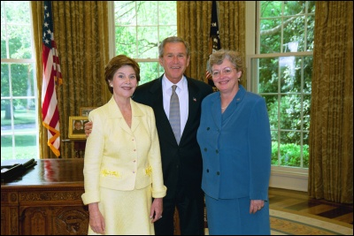 President George W. Bush and Laura Bush congratulate 2003 Maine Teacher of the Year Elspeth Corrigan Moore in the Oval Office Wednesday, April 30, 2003. White House Photo by Eric Draper