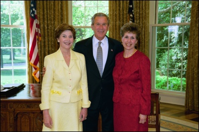 President George W. Bush and Laura Bush congratulate 2003 Maine Teacher of the Year Carol Rossi-Fries in the Oval Office Wednesday, April 30, 2003. White House Photo by Eric Draper