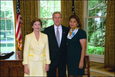 President George W. Bush and Laura Bush congratulate 2003 Commonwealth of the Northern Mariana Islands Teacher of the Year Bertha Leon Guerrero in the Oval Office Wednesday, April 30, 2003. White House Photo by Eric Draper