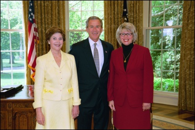 President George W. Bush and Laura Bush congratulate 2003 Maine Teacher of the Year Melissa Ellis Bartlett in the Oval Office Wednesday, April 30, 2003. White House Photo by Eric Draper