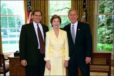 President George W. Bush and Laura Bush congratulate 2003 Maine Teacher of the Year James Kerr in the Oval Office Wednesday, April 30, 2003. White House Photo by Eric Draper