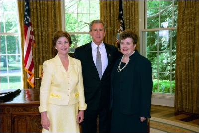 President George W. Bush and Laura Bush congratulate 2003 Maine Teacher of the Year Joyce Dunn in the Oval Office Wednesday, April 30, 2003. White House Photo by Eric Draper