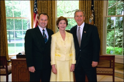 President George W. Bush and Laura Bush congratulate 2003 Maine Teacher of the Year Charles L. Boucher in the Oval Office Wednesday, April 30, 2003. White House Photo by Eric Draper