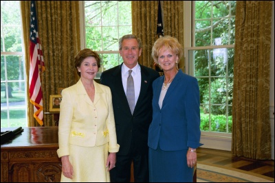 President George W. Bush and Laura Bush congratulate 2003 Maine Teacher of the Year Linda M. McKay in the Oval Office Wednesday, April 30, 2003. White House Photo by Eric Draper