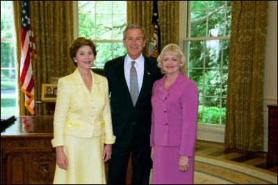 President George W. Bush and Laura Bush congratulate 2003 Maine Teacher of the Year Deborah L. Smith in the Oval Office Wednesday, April 30, 2003. White House Photo by Eric Draper