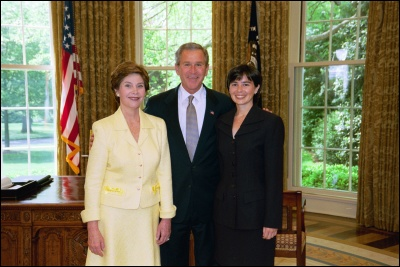 President George W. Bush and Laura Bush congratulate 2003 Maine Teacher of the Year Denise Tanner in the Oval Office Wednesday, April 30, 2003. White House Photo by Eric Draper