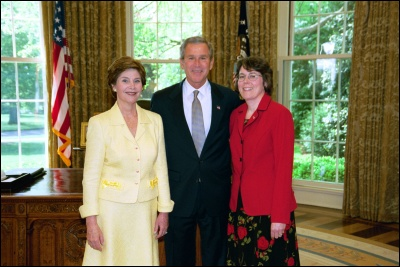President George W. Bush and Laura Bush congratulate 2003 Maine Teacher of the Year Kathleen Jacob in the Oval Office Wednesday, April 30, 2003. White House Photo by Eric Draper