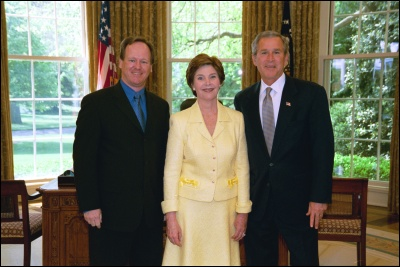 President George W. Bush and Laura Bush congratulate 2003 Maine Teacher of the Year Douglas C. Armstrong in the Oval Office Wednesday, April 30, 2003. White House Photo by Eric Draper
