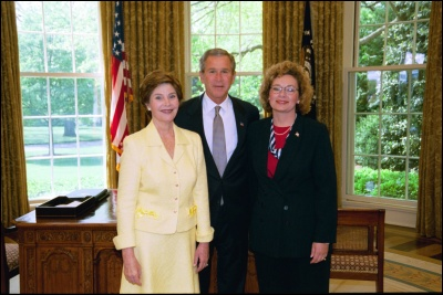 President George W. Bush and Laura Bush congratulate 2003 Maine Teacher of the Year Lorynda Archibeque Sampson in the Oval Office Wednesday, April 30, 2003. White House Photo by Eric Draper