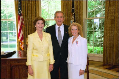 President George W. Bush and Laura Bush congratulate 2003 Maine Teacher of the Year Mary K. Devono in the Oval Office Wednesday, April 30, 2003. White House Photo by Eric Draper