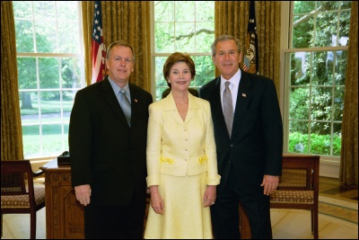President George W. Bush and Laura Bush congratulate 2003 Maine Teacher of the Year Gerald J. Hoefs in the Oval Office Wednesday, April 30, 2003. White House Photo by Eric Draper