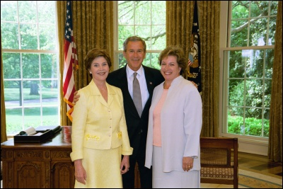 President George W. Bush and Laura Bush congratulate the 2003 National Teacher of the Year Betsy Rogers in the Oval Office Wednesday, April 30, 2003. Rodgers is a 1st and 2nd grade teacher at Leeds Elementary School in Leeds, Ala. White House Photo by Eric Draper