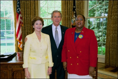 President George W. Bush and Laura Bush congratulate 2003 Maine Teacher of the Year Katherine Wright Knight in the Oval Office Wednesday, April 30, 2003. White House Photo by Eric Draper