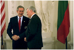During his visit to Lithuania, President Bush received the Order of Vytautas the Great from President Adamkus at the Prezidentura in Vilnius, Lithuania, Nov. 23, 2002. The medal is given to individuals whose contributions have benefited the Lithuanian nation or the welfare of mankind. White House photo by Paul Morse
