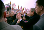 President George W. Bush greets Lithuanians in person at the Rotuse Square in the center of Vilnius, Lithuania, Nov. 23, 2002. 'This is a great day in the history of Lithuania, in the history of the Baltics, in the history of NATO, and in the history of freedom,' said President Bush in his remarks. 'And I have the honor of sharing this message with you: We proudly invite Lithuania to join us in NATO, the great Atlantic Alliance.' White House photo by Paul Morse