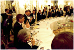President George W. Bush and Mrs. Bush attend a dinner for NATO leaders at Prague Castle in Prague, Czech Republic, Nov. 20, 2002. White House photo by Eric Draper