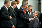 Preparing for a group photo at the NATO Summit, President George W. Bush jokes with Luxembourg's Prime Minister Jean-Claude Juncker at the Prague Congress Centre in Prague, Czech Republic, Nov. 21, 2002. Also pictured are, from left to right, Canadian Prime Minister Jean Chretien, Belgian Prime Minister Guy Verhofstadt, and Poland's President Aleksander Kwasniewski. White House photo by Paul Morse