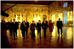 Before their bilateral meetings, President Putin and Lyudmila Putin escort President Bush and Laura Bush through the Great Hall at Catherine Palace in St. Petersburg, Russia, Nov. 22, 2002. White House photo by Eric Draper