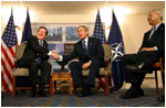 Secretary General of NATO Lord Robertson and President George W. Bush meet for a bilateral meeting in Prague, Czech Republic, Wednesday, Nov. 20.