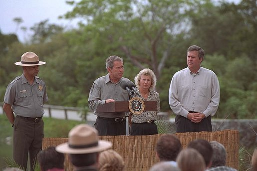 As his brother, Florida Governor Jeb Bush stands by his side, President George W. Bush speaks at the Royal Palm Visitors Center at Everglades National Park, Fla., June 4, 2001. White House photo by Eric Draper.