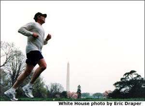President George W. Bush jogs past the Washington Monument. White House photo.